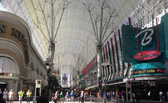 The five-block Fremont Street Experience encloses the liveliest blocks downtown, including casinos of a certain age. Atop is a zipline called SlotZilla. At night, live music cranks up the volume (Photo by David G. Molyneaux, TheTravelMavens.com)