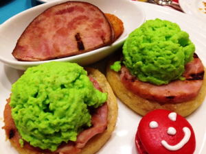 "Green eggs and ham at the Dr. Seuss Breakfast on Carnival Cruise Line ships. ""Would you, could you, on a boat? Try them while you float."" (Photo by David G. Molyneaux, TheTravelMavens.com)"