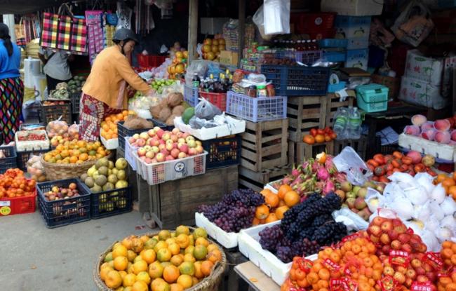 Busy market for provisioning along the Burma Road in Bhamo, Myanmar (Photo by David G. Molyneaux, TheTravelMavens.com)