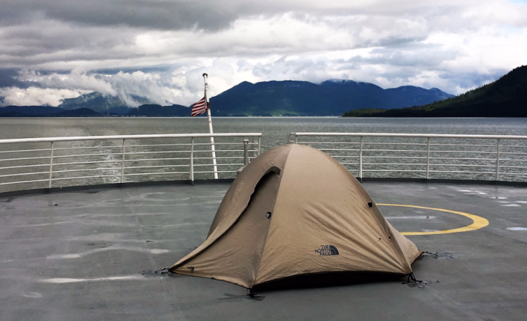A tent ready for the night as the ferry Matanuska churns toward Skagway, Alaska. (photo by Fran Golden TheTravelMavens.com)