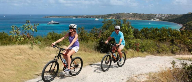 SeaDream guests biking on Anguilla during a Caribbean cruise. SeaDream Yacht Club Cruises