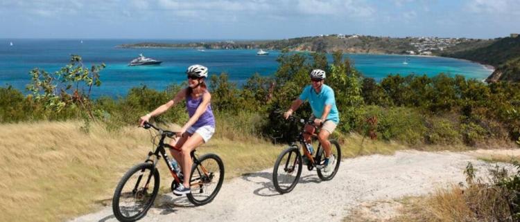 SeaDream guests biking on Anguilla during a Caribbean cruise. SeaDream Yacht Club Cruises