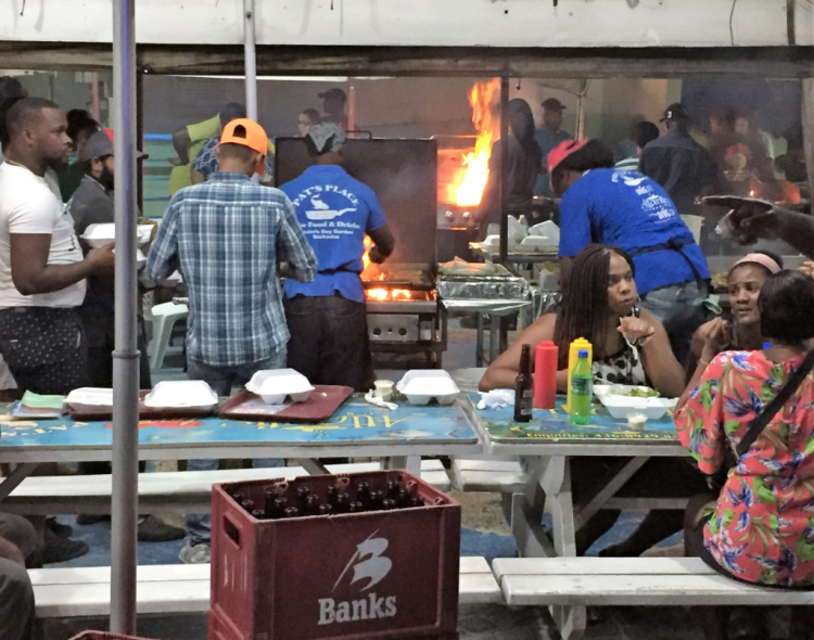 The Oistins Beach fish fry on Barbados is popular nightly, but especially on Fridays. Come early for a seat, stay late for the music. (Photo by David G. Molyneaux TheTravelMavens.com)