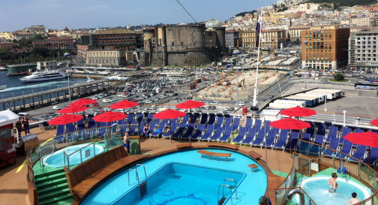 The port at Naples, Italy, as seen from the pools at the aft end of Carnival Horizon. Carnival has taken many Americans on their first visit to Europe. (Photo by David G. Molyneaux, TheTravelMavens.com)