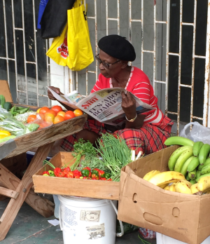 Quiet sidewalk seller of fruit and vegetables in downtown Bridgetown, Barbados. (Photo by David G. Molyneaux TheTravelMavens.com)