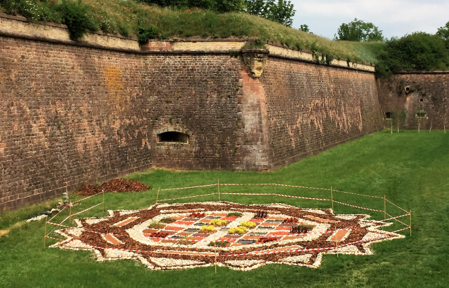 Outside the walls of the fortified city of Neuf-Brisach, France, with a design of the octagon-shaped city laid out in the grass. (Photo by David G. Molyneaux, TheTravelMavens.com)