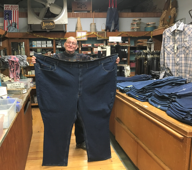 Robert Morrison, 78, a salesman at Abraham's Department Store, established in 1928 in Vicksburg, Miss.,  shows off a pair of pants for sale, with a waistband measuring 72 inches. (Photo by David G. Molyneaux, TheTravelMavens.com)