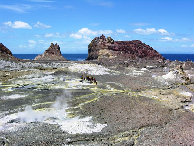 A tour group begins its walk at the tip of a volcano on White Island (Photos by David G. Molyneaux, TheTravelMavens.com)