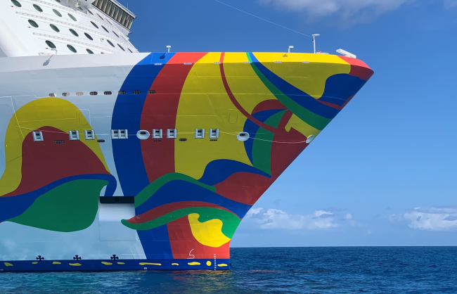 Norwegian Encore, newest big cruise ship of Norwegian Cruise Line, sails out of Miami for the winter of 2020, moving to New York in April. Eduardo Arranz-Bravo, of Barcelona, created the artwork on the hull (Photo by David G. Molyneaux, TheTravelMavens.com)