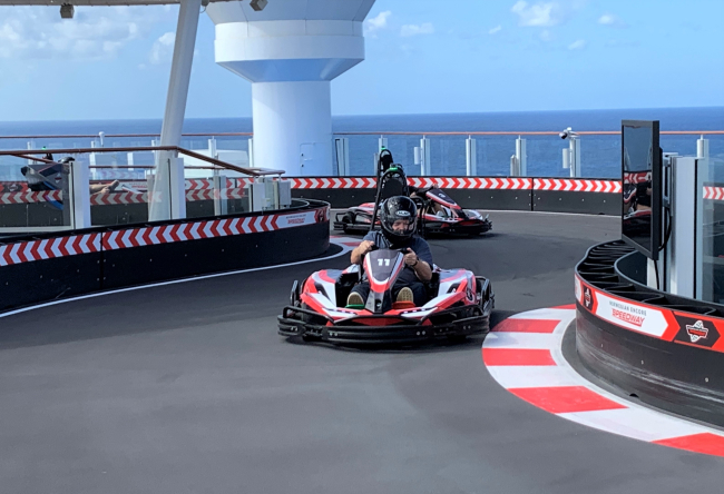 Writer David Molyneaux races in a go-kart on the top deck of Norwegian Encore (photo by Fran Golden, TheTravelMavens.com)