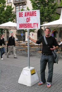 Doug Lansky stands at his Sign Spotting project, Stockholm, Sweden